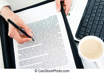 Learning documents - Close-up of business contract with...