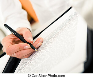 Written work - Close-up of female�s hand with pen over...