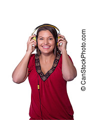 Woman holds headphones to her ears.