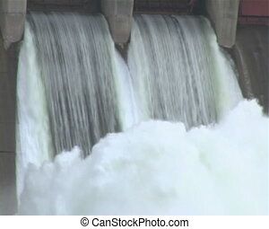 Spillway - A dam with the floodgates open, taken from the...