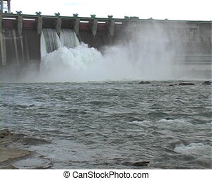 Electrical station on the river. - A dam with the floodgates...