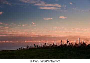 Sunset over countryside landscape