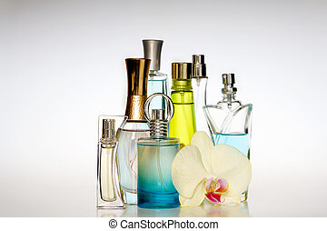 Perfume bottles - Multicolored perfumes in bottles of...