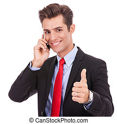 business man talking on the smart phone and making ok -...