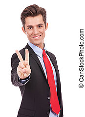 business  man showing victory sign