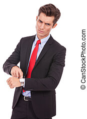 you are late! - Business man impatiently pointing to his...