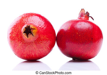 two fresh pomegranates - various views of two shiny...