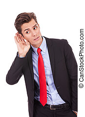 Young business man, listening