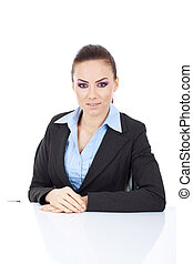Portrait of young business woman sitting at her desk with a...