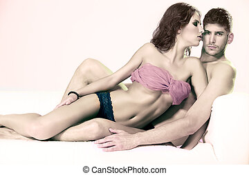 Passionate heterosexual couple in studio