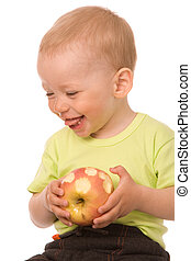 The artful child - The little boy eats the big apple on a...