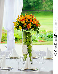 Decoration of wedding table - Bouquet in vase on decorating...