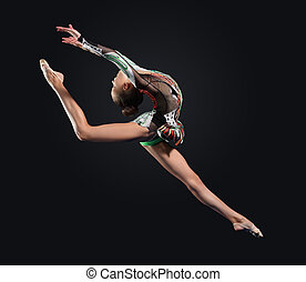 Young woman in gymnast suit posing - Young cute woman in...