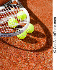Close up view of tennis racket and balls - Close up view of...