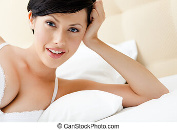 Woman in bra is lying in the bed - Woman in bra is lying in...