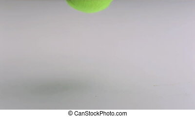 Tennis ball dropping and bouncing - Tennis ball slow motion...