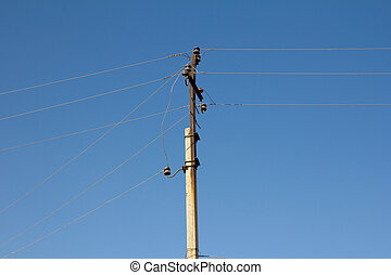 electric pole against the blue sky