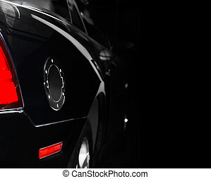 Stylish black car with chrome round lid of a fuel tank