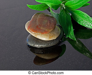 healing stones with reflection - several healing spa stones...