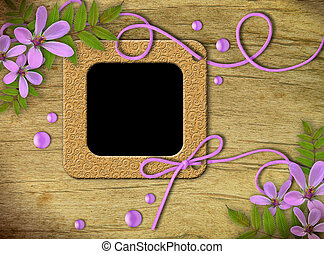 Vintage photo frames and lilac flowers on an old, cracked...