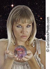 fortune teller holding a crystal ball with images of...