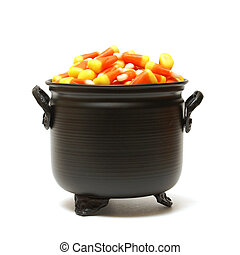 Candy Corn - A black cauldron is filled with candy corn for...