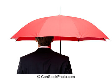 Back of the man holding umbrella overhead - Back of the man...