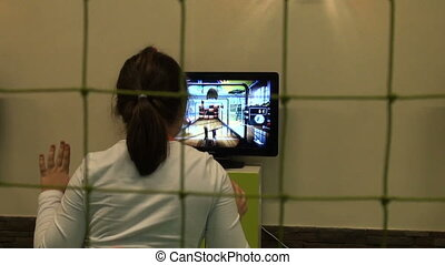 Girl playing in the computer game