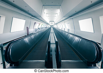 escalator in airport, shot in asia, taiwan, in blue tune