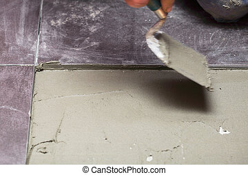 Construction level tiling at home tile floor adhesive