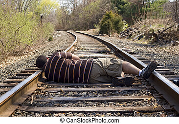 Laying on the Rails - A man laying on the railroad tracks....