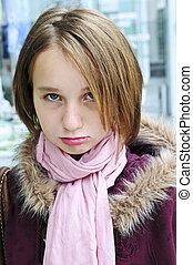 Teenage girl pouting