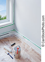 Painting a room - Renovations. Painting tools and floor...