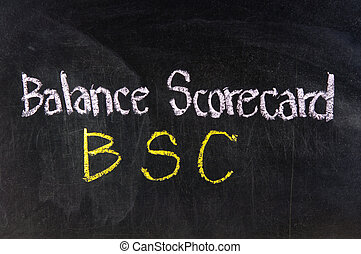 The word BSC handwritten with chalk on a blackboard