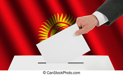 The Kyrgyz Flag and the hand with the bulletin about the...