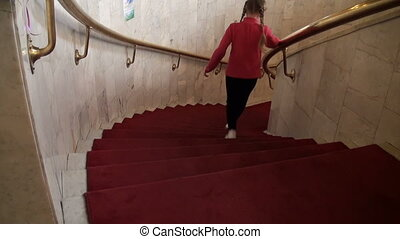 Girl goes on stairs