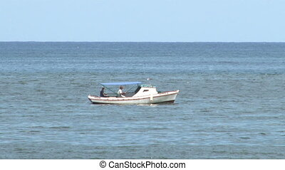 Boat moving backwards - View of blue sea with verizon...