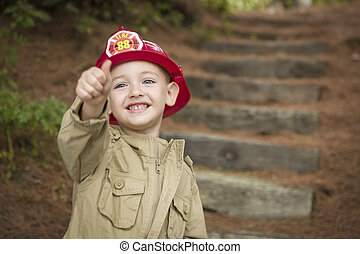 Adorable Child Boy with Fireman Hat Playing Outside - Happy...
