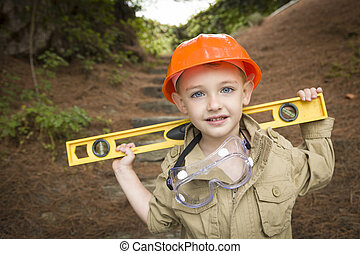 Adorable Child Boy with Level Playing Handyman Outside -...