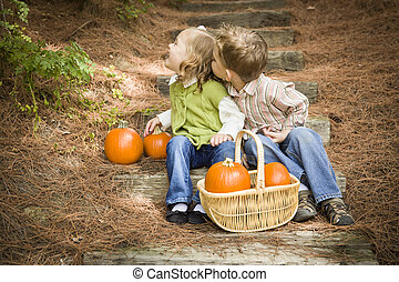 Brother and Sister Children on Wood Steps with Pumpkins Playing