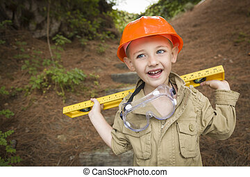 Adorable Child Boy with Level Playing Handyman Outside