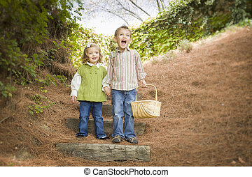 Two Children Walking Down Wood Steps with Basket Outside -...