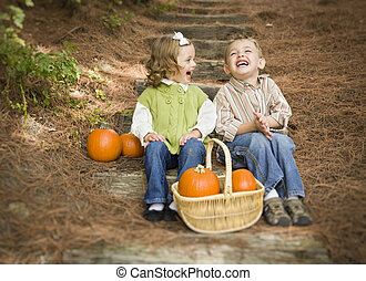 Brother and Sister Children Sitting on Wood Steps with...