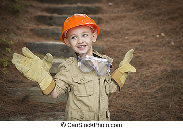 Adorable Child Boy with Big Gloves Playing Handyman Outside