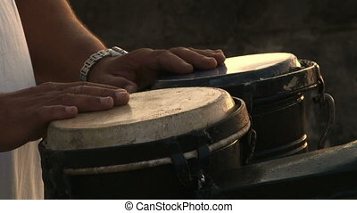 Bongo corto at Malecon Havana Cuba - Close up of two hands...