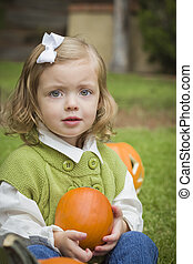 Child Girl at Pumpkin Patch - Adorable Young Child Girl...