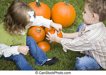 Child Boy and Girl at Pumpkin Patch - Cute Young Brother and...