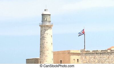 Morro castle ligth with cuban flag - A view of lighthouse in...