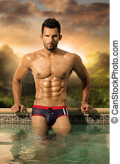 Sexy man - Sexy male model with great body and abs in pool
