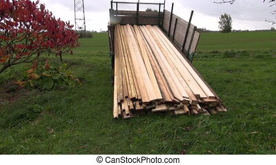 sawn timber planks stack in truck - new sawn timber planks...